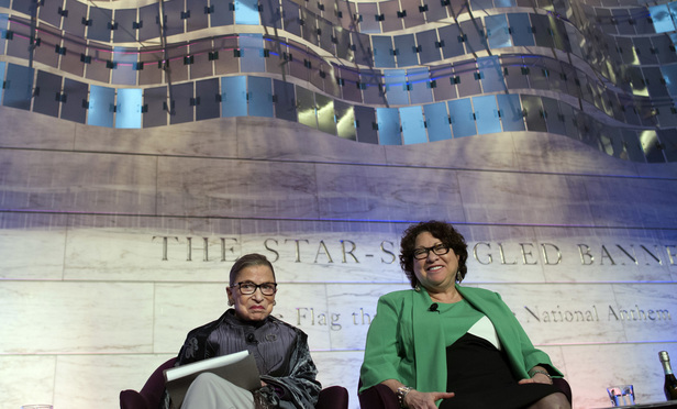 Supreme Court Justices Ruth Bader Ginsburg, left, and Sonia Sotomayor, right, discuss the food traditions of the Supreme Court at the Smithsonian Museum of American History in Washington, D.C., on Wednesday, June 1, 2016.