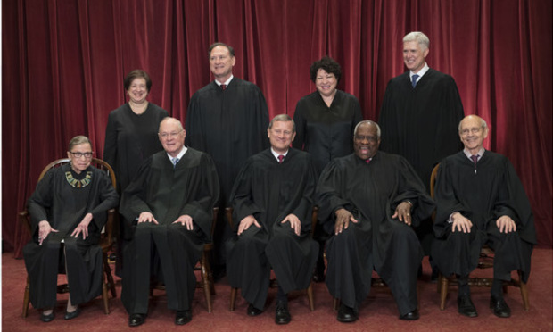 The justices of the U.S. Supreme Court gather for an official group portrait to include new Associate Justice Neil Gorsuch, top row, far right, Thursday. June 1, 2017, at the Supreme Court Building in Washington. Seated, front row, from left are, Associate Justice Ruth Bader Ginsburg, Associate Justice Anthony M. Kennedy, Chief Justice of the United States John Roberts, Associate Justice Clarence Thomas, and Associate Justice Stephen Breyer. Back row, standing, from left are, Associate Justice Elena Kagan, Associate Justice Samuel Alito Jr., Associate Justice Sonia Sotomayor, and Associate Justice Neil Gorsuch.