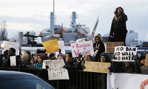 Protesters rally in front of John F. Kennedy International Airport in New York, Sunday, Jan. 29, 2017. President Donald Trump's immigration order sowed more chaos and outrage across the country Sunday, with travelers detained at airports, panicked families searching for relatives and protesters registering opposition to the sweeping measure that was blocked by several federal courts..