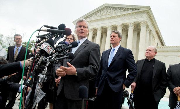 Former Virginia Gov. Bob McDonnell speaks outside the Supreme Court in Washington, Wednesday, after the court heard arguments in his corruption case.