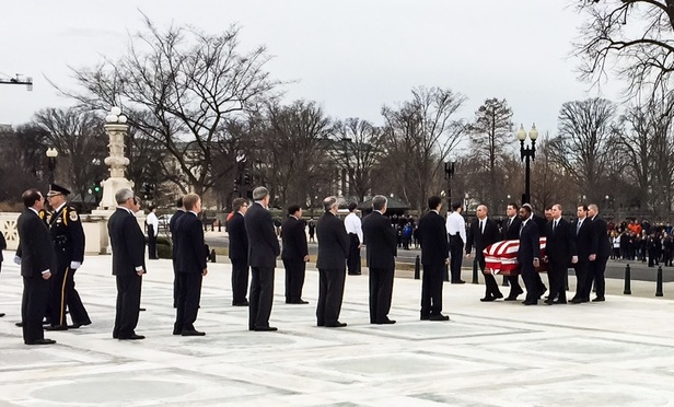 Justices, Clerks and Family Pay Respects to the 'Boss' at Scalia Memorial