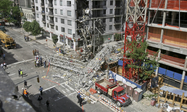 a large crane lies in an intersection after it collapsed on the East Side of Manhattan in May 2008.
