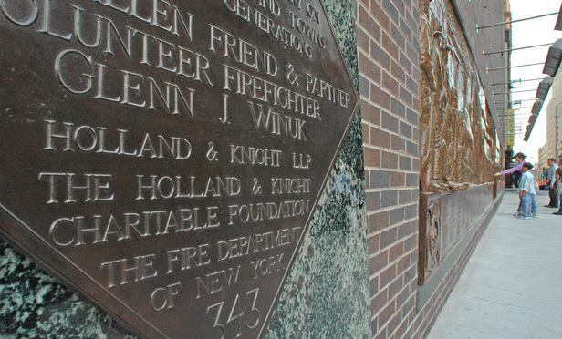 Holland & Knight installed a memorial to firefighters killed on 9/11 outside an engine company across the street from where the South Tower once stood.