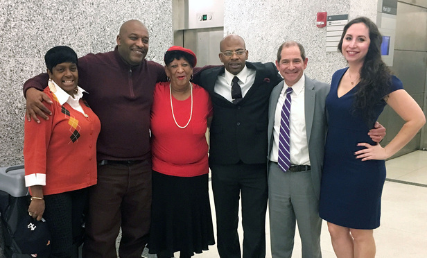 John Bunn, third from right, poses with family members and attorneys Glenn Garber and Rebecca Freedman of the Exoneration Initiative at Brooklyn Supreme Court on Nov. 29 following a judge's decision to vacate Bunn's 24-year-old murder conviction.