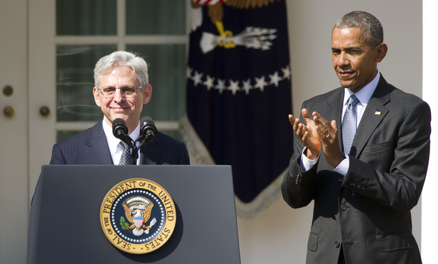 D.C. Circuit Chief Judge Merrick Garland, left, speaks after President Barack Obama announced his nomination to the U.S. Supreme Court Wednesday.