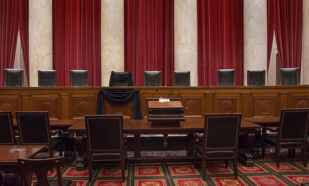 Scalia's chair and the bench were draped in black after his death on Feb. 13.