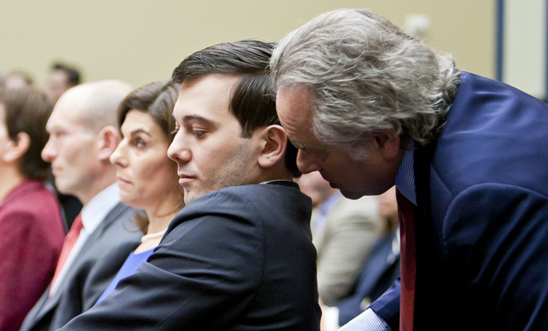 Martin Shkreli hears advice from attorney Benjamin Brafman during a 2016 hearing by the House Committee on Oversight and Government Reform.