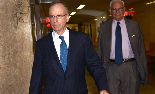 Former Dewey & LeBoeuf chairman Steven Davis, left, entering court with his attorney Elkan Abramowitz on August 27.