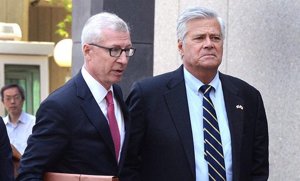 Dean Skelos, right, and his attorney Robert Gage Jr. leave federal court after sentencing.
