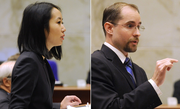 Miriko Hirose of the New York Civil Liberties Union, representing the gay couple who sought to be married at Liberty Ridge Farm, and Caleb Dalton, counsel to the owners of the farm, argue at the Third Department Monday.