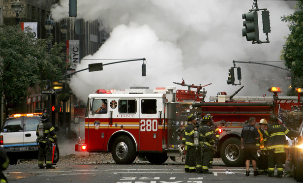Emergency personnel at the site of the steam pipe explosion near Grand Central Terminal in July 2007.