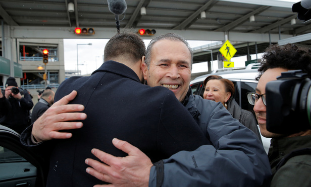 Iraqi immigrant Hameed Khalid Darweesh is embraced after his release.