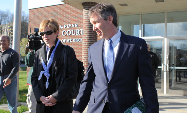 Douglas Kennedy, son of the late Sen. Robert F. Kennedy, and his wife Molly, arrive at Mount Kisco village court in 2012.