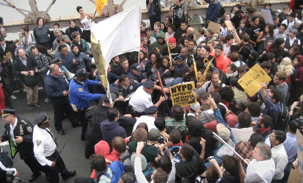 NYPD officers enter a crowd of protesters on the Brooklyn Bridge in October 2011.