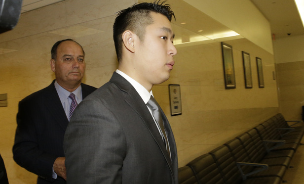 New York City police officer Peter Liang, right, and his attorney Stephen Worth leave the courtroom after Liang pleaded not guilty during his arraignment at Brooklyn Supreme Court on Wednesday.