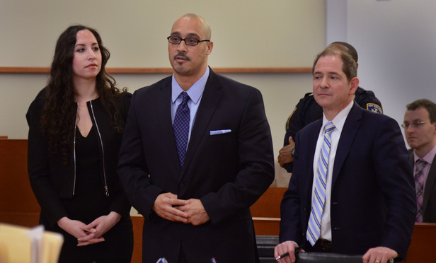 Richard Rosario, center, with his attorneys Rebecca Freedman and Glenn Garber during the March 23 court proceeding where his murder conviction was overturned.