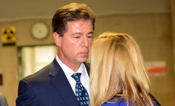 Joel Sanders, former CFO of Dewey & LeBoeuf, speaks to an unidentified woman outside the courtroom after he was found guilty Monday.