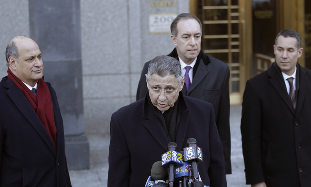 New York State Assembly Speaker Sheldon Silver speaks to the media as he leaves the Southern District federal court on Thursday after his arrest on public corruption charges. Silver is surrounded by his counsel, from left, Joel Cohen, a partner at Stroock & Stroock & Lavan; and Steven Molo and Justin Shur, partners at MoloLamken.