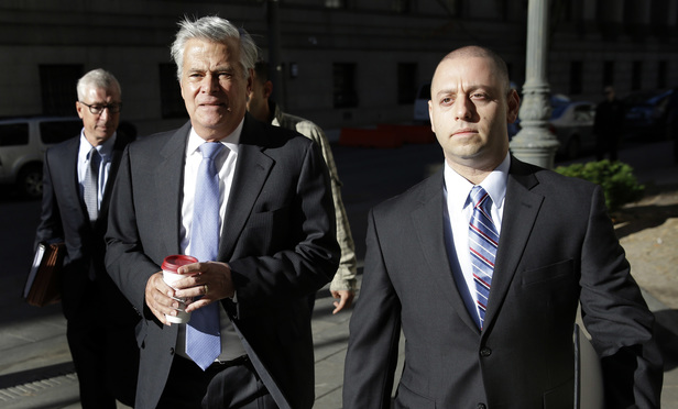 Dean Skelos, center, and his son Adam Skelos, right, arrive to court Tuesday, accompanied by G. Robert Gage, left, of Gage Spencer & Fleming, who leads the legal team for Dean Skelos.