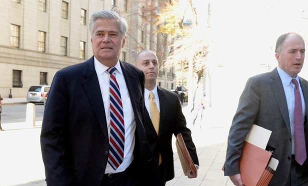 Former New York State Senate Majority leader Dean Skelos, left, his son, Adam Skelos, center and Christopher Conniff, a partner at Ropes & Gray who is representing Adam Skelos, enter court on Nov. 16.