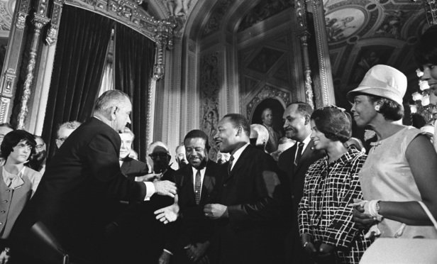 President Lyndon B. Johnson meets with Martin Luther King, Jr. at the signing of the Voting Rights Act of 1965