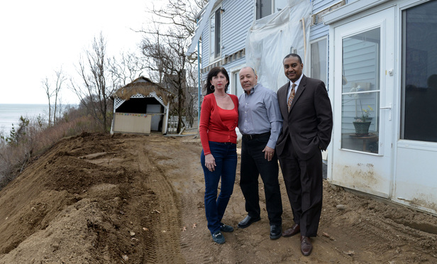 Fred and Teresa Tovar with their attorney, Ivan Young, at the Tovar home in Sound Beach, Long Island.