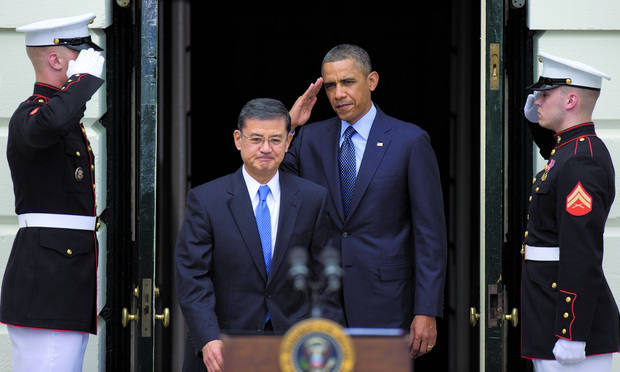 RESIGNED: Eric Shinseki, center, seen here in 2013, resigned on May 30 as the secretary of the U.S. Department of Veterans Affairs amid widespread criticism of the delivery of care to veterans.