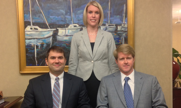 "Owen Murphy, at left, Gini Lynn Jenkins and Roy ""Rob"" Kelly IV represented the plaintiffs."