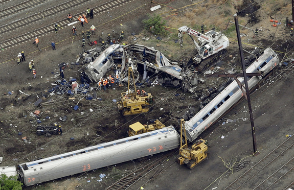FILE- In this May 13, 2015 file photo, emergency personnel work at the scene of a night derailment in Philadelphia of an Amtrak train headed to New York. Amtrak has started settling lawsuits with victims of last year's deadly derailment in Philadelphia, and lawyers involved in the process say a strict confidentiality provision prevents them from talking about how they're doing or how much money they've received. (AP Photo/Patrick Semansky, File)