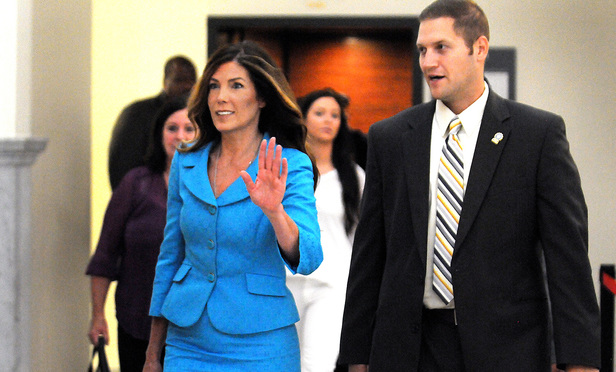 Pennsylvania Attorney General Kathleen Kane waves as she enters the Montgomery County courtroom on Thursday, August 11, 2016, to continue her trial in Norristown, Pa. Kane, a first-term Democrat, is accused of leaking secret grand jury documents to the press and lying about it under oath. (Art Gentile/Bucks County Courier Times via AP, Pool)