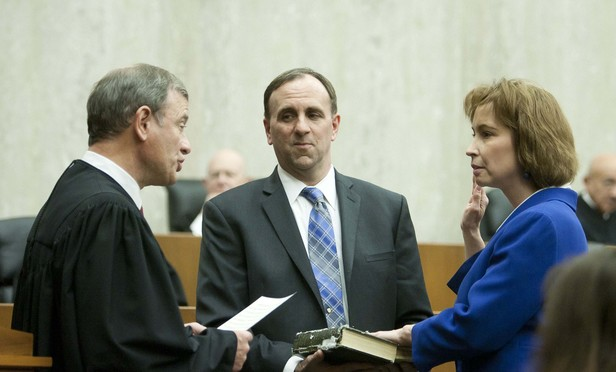 Chief Justice John Roberts Jr. swears in D.C. Circuit Judge Patricia Millett.