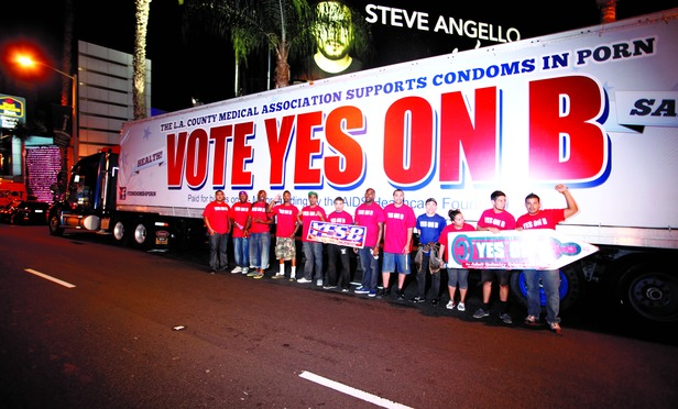 Supporters of Vote Yes on B in Los Angeles, the condoms in porn measure on the November ballot led by AIDS Healthcare Foundation, hand out voter information and free condoms on L.A's famed Sunset Strip.