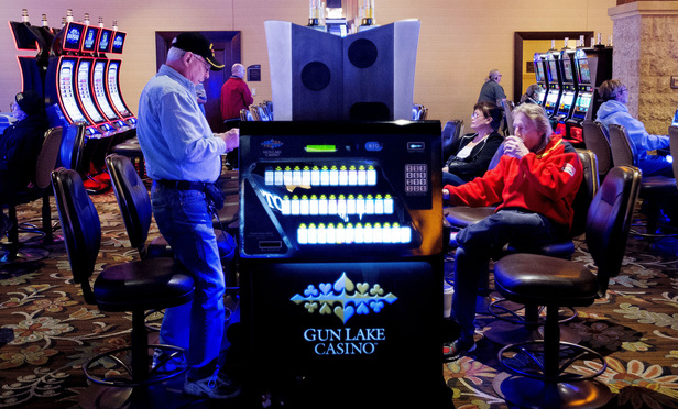 Patrons gamble at Gun Lake Casino on Monday, April 11, 2016 in Weyland, Mich.