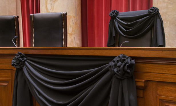 Supreme Court Associate Justice Antonin Scalia's Bench Chair and the Bench in front of his seat draped in black following his death on February 13, 2016.