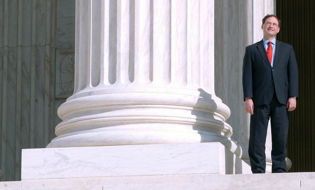 Justice Samuel Alito on top of the steps of the Supreme Court.