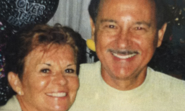 This photo made in 2000 and provided by Barbara Speranza via her attorney, shows Barbara Speranza, left, and her late husband Robert Speranza. Barbara Speranza is seeking damages against Stewart Leonard Sr., founder of Connecticut-based Stew Leonard's grocery store chain, and his son Thomas Leonard, for the death of Robert Speranza, who was swept off Leonard's boat and died in August 2011. A law suit was filed Wednesday March 7, 2012 in Bridgeport, Conn., Superior Court. (AP Photo/Courtesy of Barbara Speranza)
