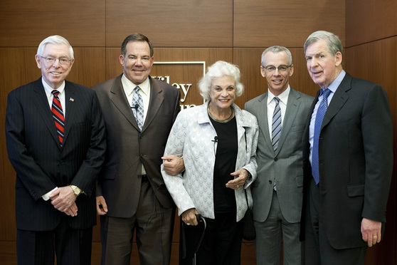 (l-r) Richard Wiley, Andrew McBride, Justice Sandra Day O'Connor, Peter Shields, and Bert Rein, pose for a photo before Justice O'Connor is to give a talk on her new book, Out of Order, at Wiley Rein's D.C. office. April 3, 2013. Photo by Diego M. Radzinschi/THE NATIONAL LAW JOURNAL.