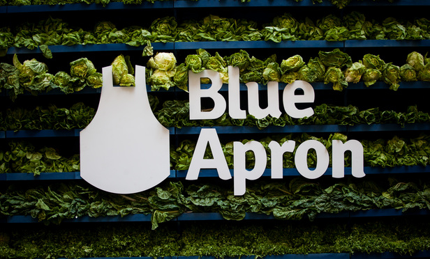 Blue Apron Holdings Inc. signage is displayed during the company's initial public offering (IPO) outside the New York Stock Exchange (NYSE) in New York, U.S., on Thursday, June 29, 2017. Meal-kit delivery company Blue Apron Holdings Inc. climbed in its trading debut after slashing the price of its initial public offering. Photographer: Michael Nagle/Bloomberg