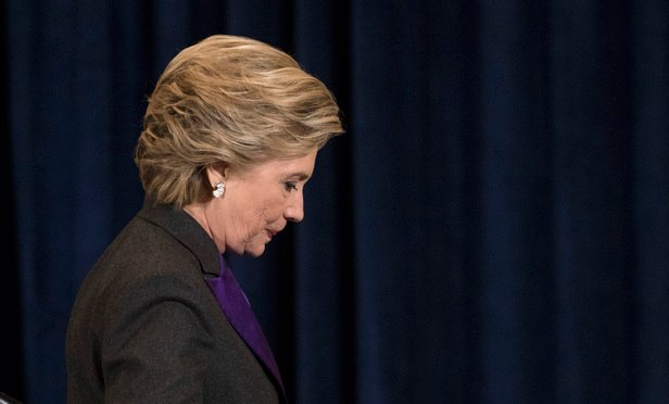 Democratic presidential candidate Hillary Clinton walks off the stage after speaking in New York, Wednesday, Nov. 9, 2016. Clinton conceded the presidency to Donald Trump in a phone call early Wednesday morning.