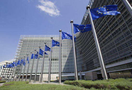 European Union flags in front of the Berlaymont building in Brussels, Belgium. Credit: Jan Kranendonk/iStockphoto.com.
