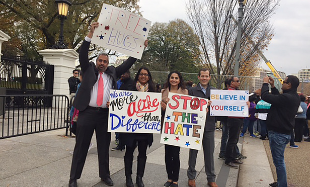 Neel Chatterjee outside of the White House on Nov. 16 with Orrick associates Amisha Patel, Dina Rezvani and Cory Lankford.