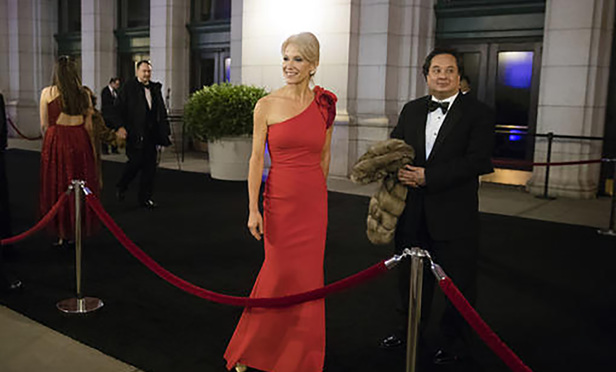 Kellyanne Conway, center, accompanied by her husband, George, speaks with members of the media as they arrive for a dinner at Union Station in Washington, the day before Trump's inauguration, on Thursday, Jan. 19, 2017.