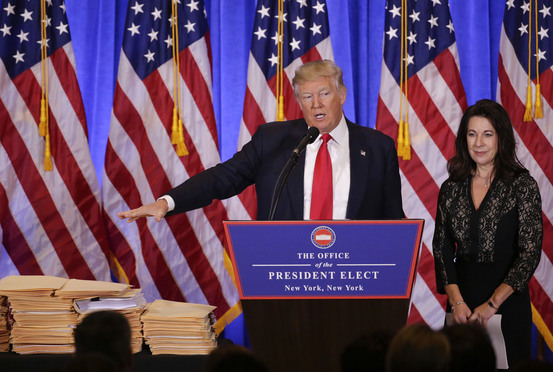 President-elect Donald Trump speaks as one of his attorneys, Sheri Dillon, of Morgan Lewis & Bockius, listens during a news conference, Wednesday, Jan. 11, 2017, in New York. The news conference was his first as President-elect.