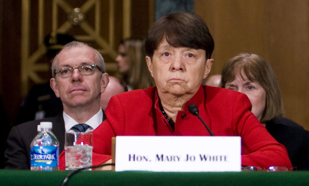 Mary Jo White, center, speaking before the U.S. Senate Committee on Banking, Housing, and Urban Affairs, during her confirmation hearing to be chairman of the Securities and Exchange Commission, on March 12, 2013. Behind her, left, is her husband, John White, a partner with Cravath, Swaine & Moore.