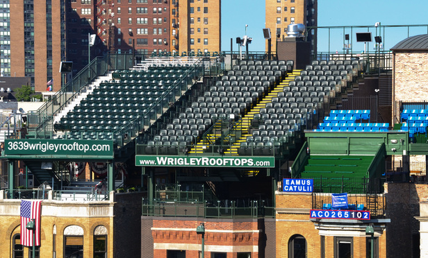 Outfield Rooftop seats located across N. Sheffield Avenue from the right outfield allow patrons to view the games at Wrigley Field Stadium in Chicago.