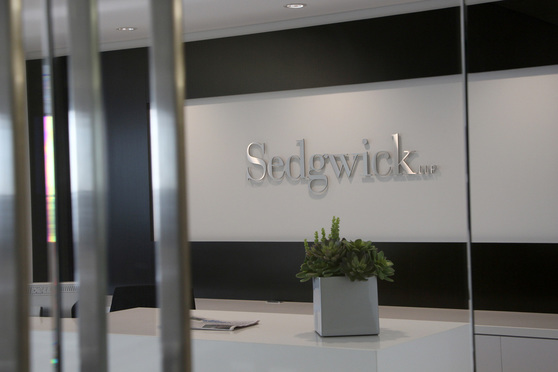 06/18/15- Miami- Sedgwick LLP, logo in Miami office reception area.