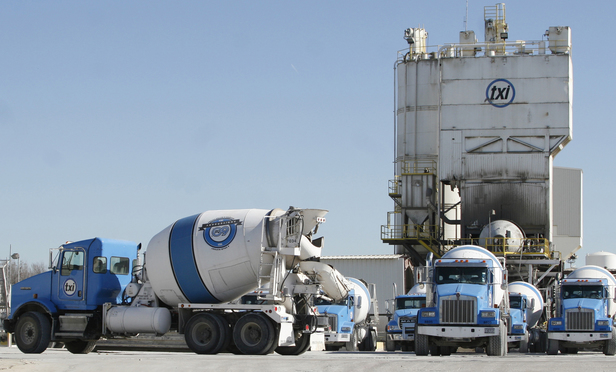Cement trucks outside a Texas Industries Inc. plant in Dallas, Texas