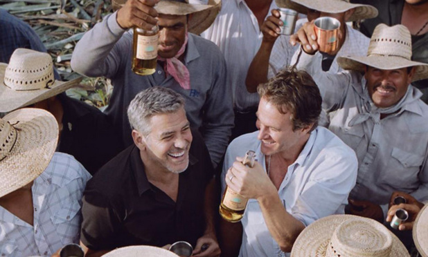 George Clooney and friends, presumably celebrating the sale of Casamigos Tequila