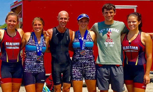 Jeff Dorrill, third from the left, is pictured with some fellow members of the University of Alabama triathlon team at the Rocketman Triathlon in Huntsville, Alabama, in August 2016.