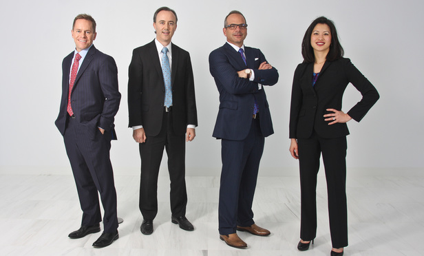From left: Eric D. Madden, P. Jason Collins, William T. Reid IV and Lisa S. Tsai of Reid Collins Tsai in Austin